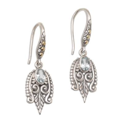 Gold accent blue topaz dangle earrings, 'Dewdrop Caress' - Balinese Gold Accent Sterling Silver Blue Topaz Earrings