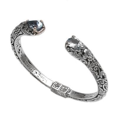 Blue topaz cuff bracelet, 'Transcendent Forest' - Floral Blue Topaz and Silver Cuff Bracelet from Bali