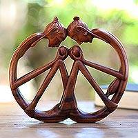 Wood sculpture, 'Love Cycle' - Hand Carved Wood Sculpture of Lovers in Wheel Shape