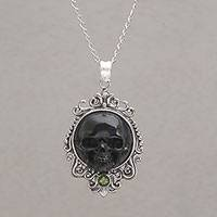 Peridot pendant necklace, 'Skull Stare in Black' - Peridot and Bone Black Skull Pendant Necklace from Bali