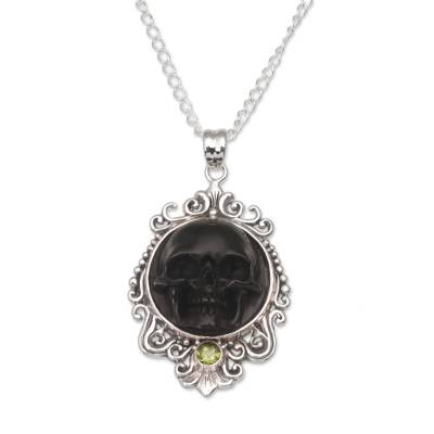 Peridot pendant necklace, 'Skull Stare in Black' - Peridot and Bone Black Skull Pendant Necklace from Bali
