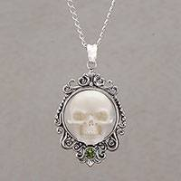 Peridot pendant necklace, 'Skull Stare in White' - Peridot and Bone White Skull Pendant Necklace from Bali