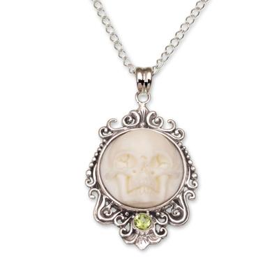 Peridot pendant necklace, 'Skull Stare in White' - Peridot and Bone White Skull Pendant Necklace from Bali