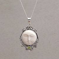 Peridot pendant necklace, 'Moonlight Stare' - Peridot and Bone Moon Pendant Necklace from Bali