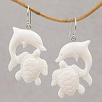Bone dangle earrings, 'Friends Among the Waves' - Bone Dangle Earrings with Dolphin and Tortoise Theme