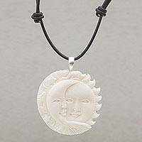 Bone pendant necklace, 'Stellar Guardians' - Handcrafted Sun and Moon Bone Pendant Necklace from Bali