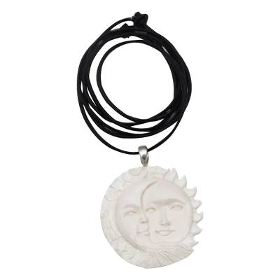Bone pendant necklace, 'Stellar Guardians' - Handcrafted Sun and Moon Bone Pendant Necklace from Bali
