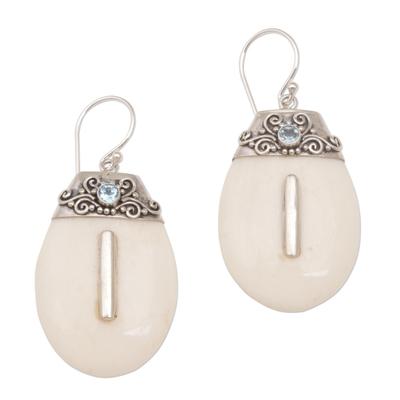 Bone and blue topaz dangle earrings, 'Sacred Pebbles' - Sterling Silver and Blue Topaz Dangle Earrings with Bone