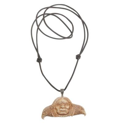 Bone pendant necklace, 'Untethered Spirit' - Handcrafted Spiritual Bone Pendant Necklace from Bali