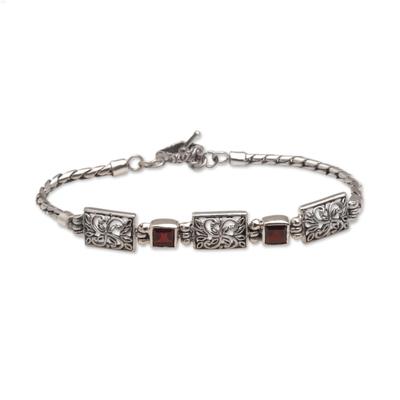 Garnet pendant bracelet, 'Kawung Blossom' - Javanese Batik Motif Pendant Bracelet with Garnets