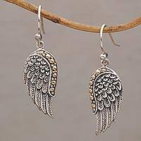 Gold accented sterling silver dangle earrings, 'Gleaming Swan Wings' - Gold Accent Sterling Silver Wing Dangle Earrings from Bali