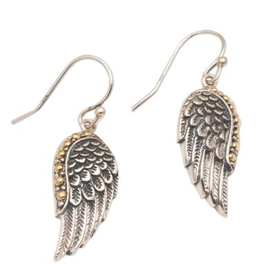 Gold accented sterling silver dangle earrings, 'Gleaming Swan Wings' - Gold Accent Sterling Silver Wing Dangle Earrings from Bali