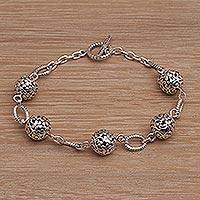 Sterling silver link bracelet, 'Garden Orbs' - Floral Sterling Silver Link Bracelet from Bali