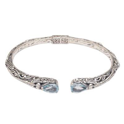 Blue topaz cuff bracelet, 'Looking for You' - Sterling Silver Hinged Blue Topaz Cuff Bracelet from Bali