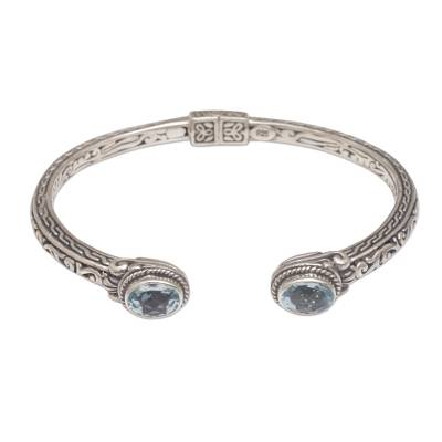 Blue topaz cuff bracelet, 'Magical Attraction' - Modern Balinese 925 Silver and Blue Topaz Cuff Bracelet