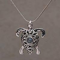 Blue topaz pendant necklace, 'Tulamben Turtle' - Handcrafted Sterling Silver Turtle Necklace with Blue Topaz