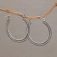 Sterling silver hoop earrings, 'On Rotation' (1.4 inch) - Sterling Silver Hoop Earrings with Textured Details (1.4 In)