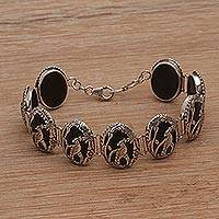 Onyx link bracelet, 'Cockatoo Garden' - Onyx and Sterling Silver Link Bracelet with Cockatoo Motif