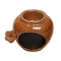 Ceramic oil warmer, 'Frangipani Glow' - Cinnamon Colored Ceramic Oil Warmer with Floral Accent