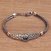 Blue topaz pendant bracelet, 'Kebun Raya Walk' - Pendant Style Silver Bracelet with Faceted Blue Topaz