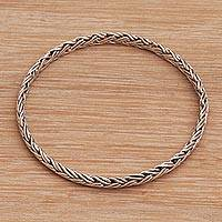 Sterling silver bangle bracelet, 'Gianyar Braid' - Braided Sterling Silver Bangle Bracelet from Bali