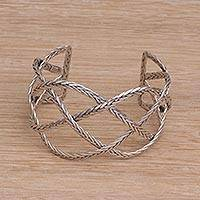 Sterling silver cuff bracelet, 'Woven Road' - Sterling Silver Handcrafted Cuff Bracelet with Braided Motif