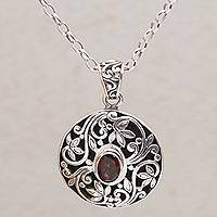 Garnet pendant necklace, 'Floral Eye in Red' - Artisan Handmade 925 Sterling Silver Garnet Pendant Necklace