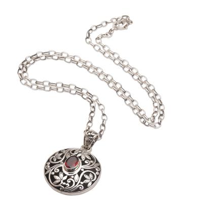 Garnet pendant necklace, 'Floral Eye in Red' - Artisan Handmade 925 Sterling Silver Garnet Pendant Necklace