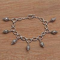 Sterling silver charm bracelet, 'Captivate' - Hand Crafted Sterling Silver Charm Bracelet