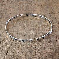 Sterling silver bangle bracelet, 'Circle of Paws' - Paw Print Motif Sterling Silver Bangle Bracelet from Bali