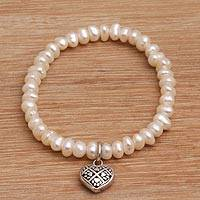 Cultured pearl beaded stretch bracelet, 'Canine Heart' - Heart Charm Cultured Pearl Beaded Stretch Bracelet from Bali