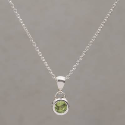 Peridot pendant necklace, 'Glowing Paws' - Peridot and Sterling Silver Pendant Necklace from Bali