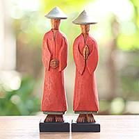 Wood statuettes, 'Neighborly Couple' (pair) - Hand Carved Red Robed Wood Farmer Statuettes (Pair)