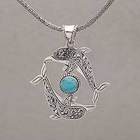 Blue topaz pendant necklace, 'Dolphin Harmony' - Sterling Silver Reconstituted Turquoise Dolphin Necklace