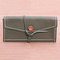Leather wallet, 'Enveloping Leather' - Handmade Leather Strap Wallet Button Closure Bali Hand Sewn