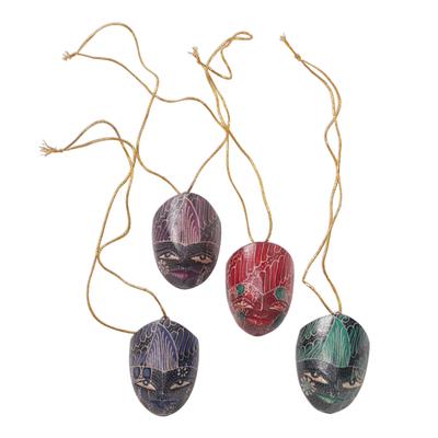 Wood batik ornaments, 'Parang Warriors' (set of 4) - Hand Carved Wadang Wood Panang Warrior Ornaments (Set of 4)