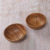 Teakwood bowls, 'Lezat' (pair) - Pair of Hand Carved Teakwood Bowls from Bali