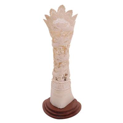Bone statuette, 'Four Dragons' - Hand-Carved Dragon-Themed Bone Statuette from Bali