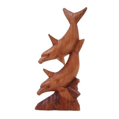 Wood sculpture, 'Wandering Dolphins' - Dolphin-Themed Suar Wood Sculpture from Indonesia