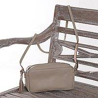 Leather sling, 'Kalibiru Snow' - Handmade Wheat Leather Sling Shoulder Bag Crafted in Bali