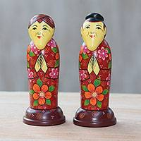 Mahogany toothpick holders, 'Elderly Friends in Red' (pair) - Pair of Mahogany Toothpick Holders in Floral Red from Bali