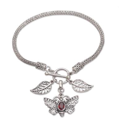 Garnet charm bracelet, 'Butterfly Dawn' - Garnet and Silver Butterfly Charm Bracelet from Bali