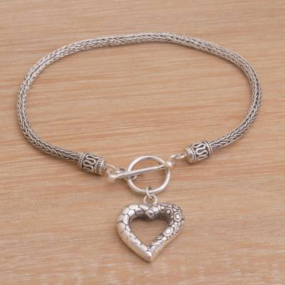 Sterling silver charm bracelet, 'Love Is Complex' - Sterling Silver Heart Charm Bracelet Crafted in Bali