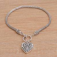 Sterling silver charm bracelet, 'Love Is Endless' - Sterling Silver Bracelet with Heart Charm Crafted in Bali