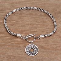 Sterling silver charm bracelet, 'Pis Bolong Coin' - Sterling Silver Coin Charm Bracelet Crafted in Bali