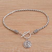 Sterling silver charm bracelet, 'Temesir Omkara' - Sterling Silver Om Charm Bracelet Crafted in Bali