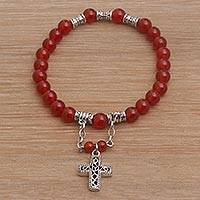 Carnelian beaded stretch charm bracelet, 'Sunset Cross' - Carnelian Beaded Stretch Bracelet with Sterling Silver Cross