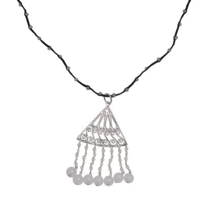 Rainbow moonstone and moonstone pendant necklace, 'Rise and Fall in Black' - Rainbow Moonstone and Moonstone Black Cord Pendant Necklace