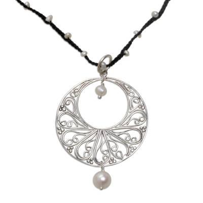 Cultured pearl pendant necklace, 'Moonlit Dance in Black' - Cultured Freshwater Pearl and Black Cord Pendant Necklace