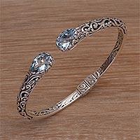 Blue topaz cuff bracelet, 'Entangled' - Blue Topaz Sterling Silver Delicate Cuff Bracelet